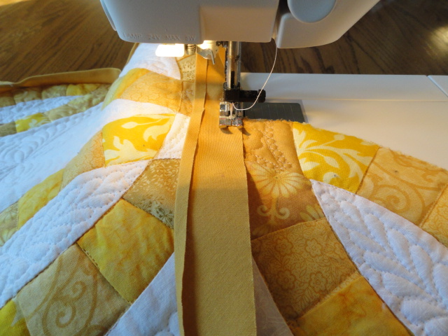 Sewing the binding to the corners.