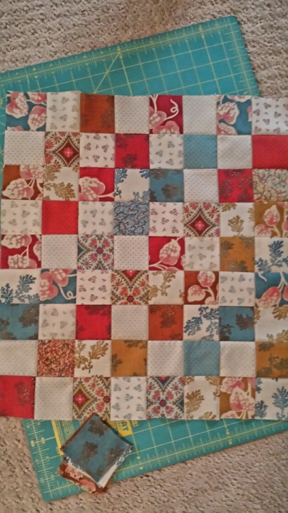tiny quilt made from mini charm packs